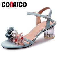 CONASCO Summer Sweet Sandals Women Suede Leather High Heels Flower Decoration Buckle Strap Sandals Shoes Woman Basic Sandals