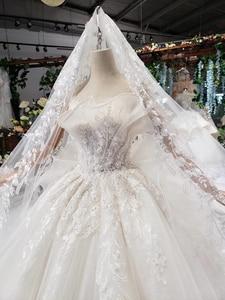 Image 5 - HTL496ドバイ王女のウェディングドレスフリルロングトレイン特別なストラップレスブライダルドレス結婚式ベールsukienka biala