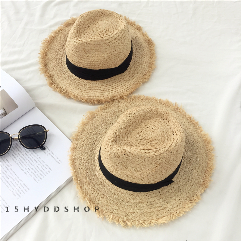 Classical tea party hats are an effective accessory to make you look great  on summer beach ce85c5e0ab65