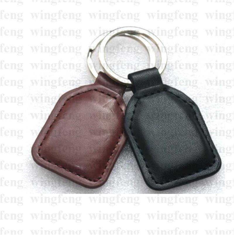 Factory Make ISO14443A Proximity Genuine Leather Black 13.56Mhz RFID Tag Writable 13.56mhz RFID Keyfob turck proximity switch bi2 g12sk an6x