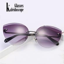 707ec767bb Nueva moda montura gafas de sol mujer Ojo de gato marino lente gafas de sol  sin marco de recorte gafas para mujer