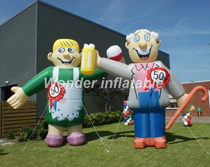 Customized Netherland giant inflatable Abraham and Sarah with number signs old man woman cartoon model for sale
