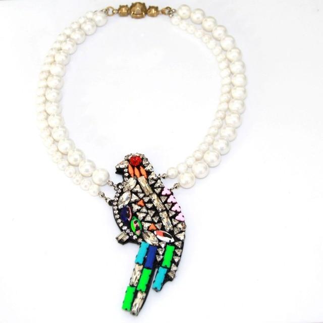 collier perle oiseau