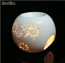 Creative Pure white hollow Oil Burner ceramic Aroma Burner fresh air Home Decor use in living room
