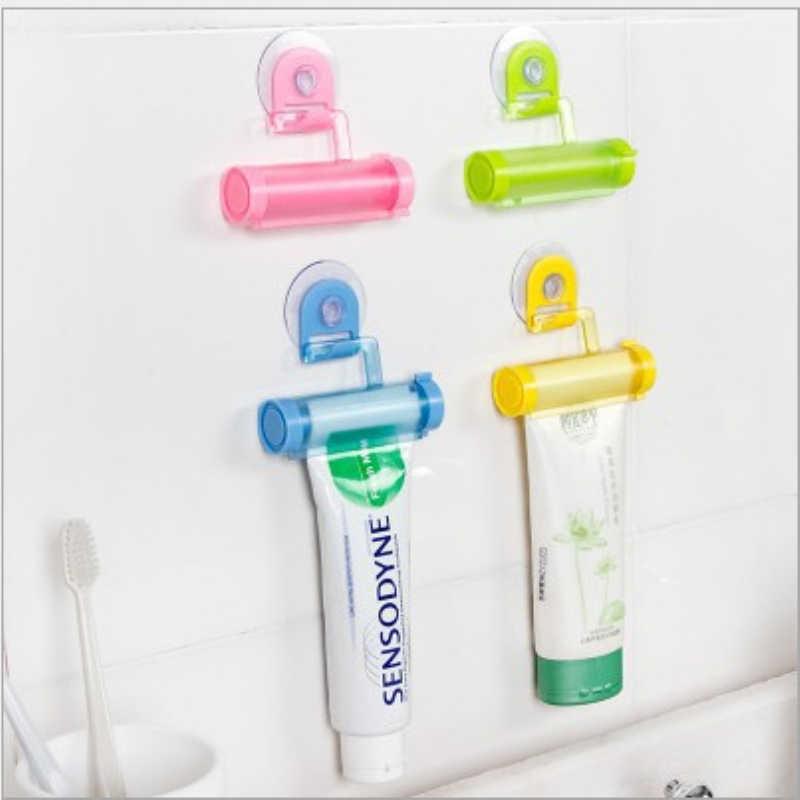 Creme dental acessórios do banheiro manual seringa arma dispenser rolamento squeezer dispensador de creme dental tubo otário titular