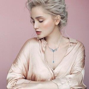 Image 3 - Sg 925 prata esterlina pena asas colar para as mulheres azul cristal e zircão pingente colares é um presente de jóias de moda