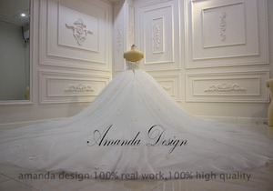 Image 4 - Amanda Design vestido de novia manga larga Strapless Lace Applique Puffy Ball Gown Wedding Dress