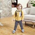 Детские костюмы с подтяжками джентльмен мальчик день рождения dress дети импортных-одежда с длинным рукавом желтый рубашка + брюки новорожденного одежда