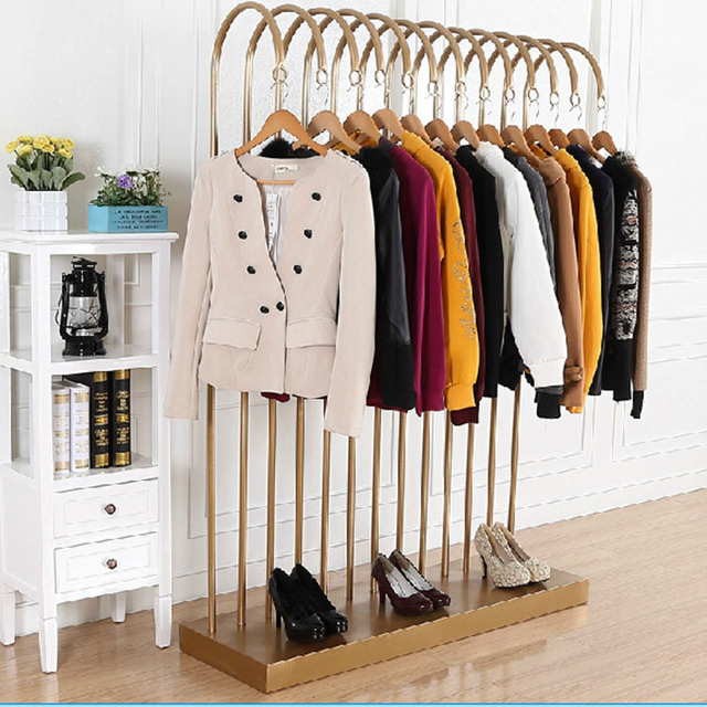Standing clothing rack side against the wall to hang