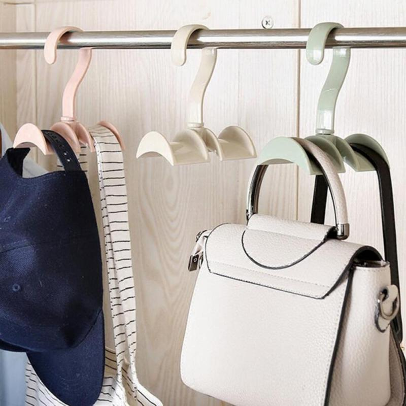 Rotated storage rack bag hanger without punch clothes for Creative clothes hangers