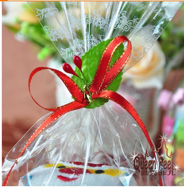 10pcs / lot rajzfilm torta törölköző Santa Clau és hóember az OPP táskában karácsonyi party gyerek ajándék törölköző pamut 30 * 30cm törölköző