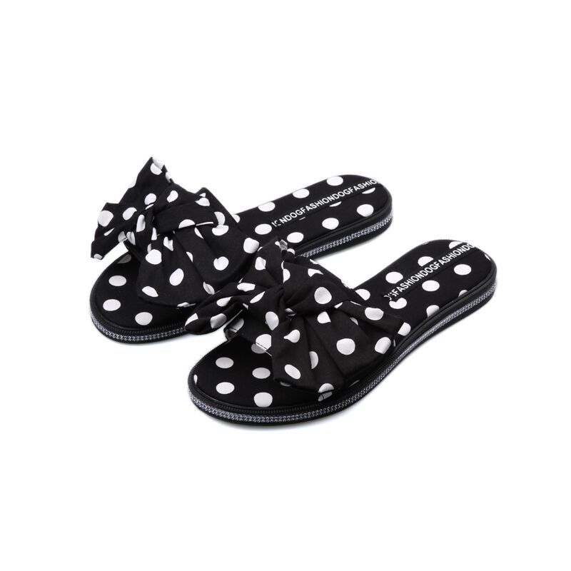 2018 new slippers female summer wear flat bow wave word slippers fashion cool slippers tide.