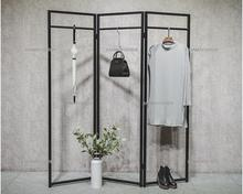 Clothes store display stand floor-to-floor Coat rack women's clothing store simple retro iron screen side hung in the island she постер cheetah in the store