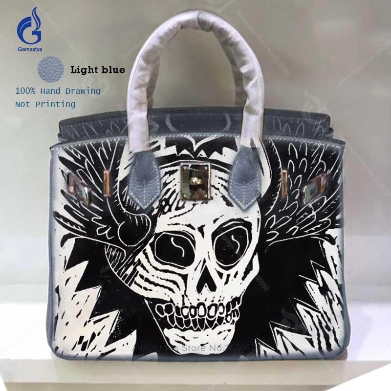 Sacs à bandoulière pour femmes 2018 100% sacs à main en cuir véritable dessin à la main noir blanc crâne fourre-tout décontractés classique Togo sac en cuir