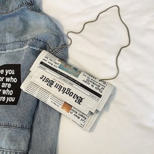 Newspapers modeling day clutch