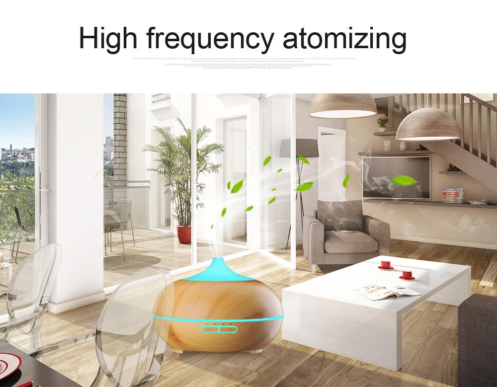 Diffuseur d'huiles essentielles KBAYBO design bois et LED dans la salle à manger
