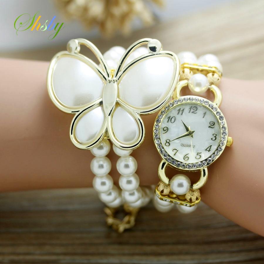 Shsby New Fashion Women Dress Watches Ladies Pearl Chain White Flower Bracelet Quartz Wristwatches Women Rhinestone Watches