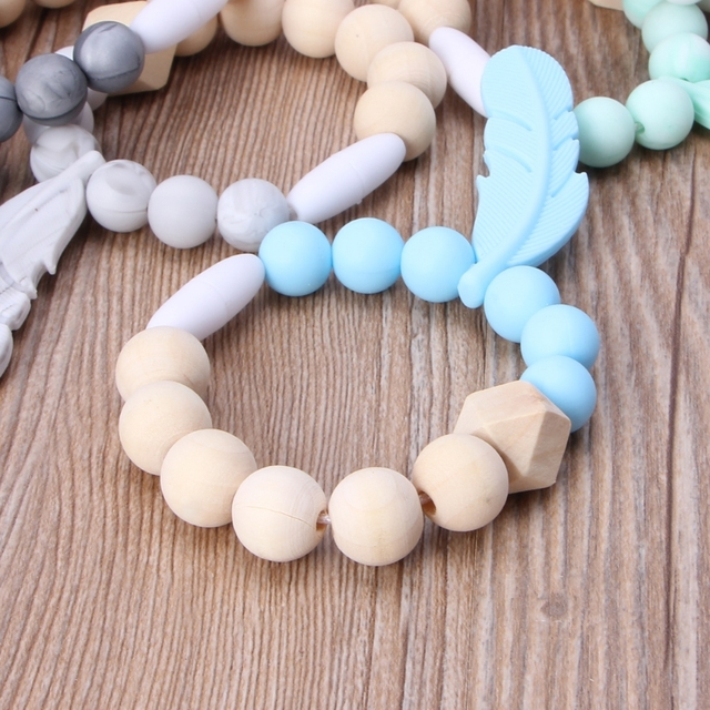 US $1 66 18% OFF|Infant Teether Bracelet Baby Feather Wood & Silicone  Teether Rings Beech Wood Teething Bracelet Infant Chew Toy Gifts BPA  FREE-in