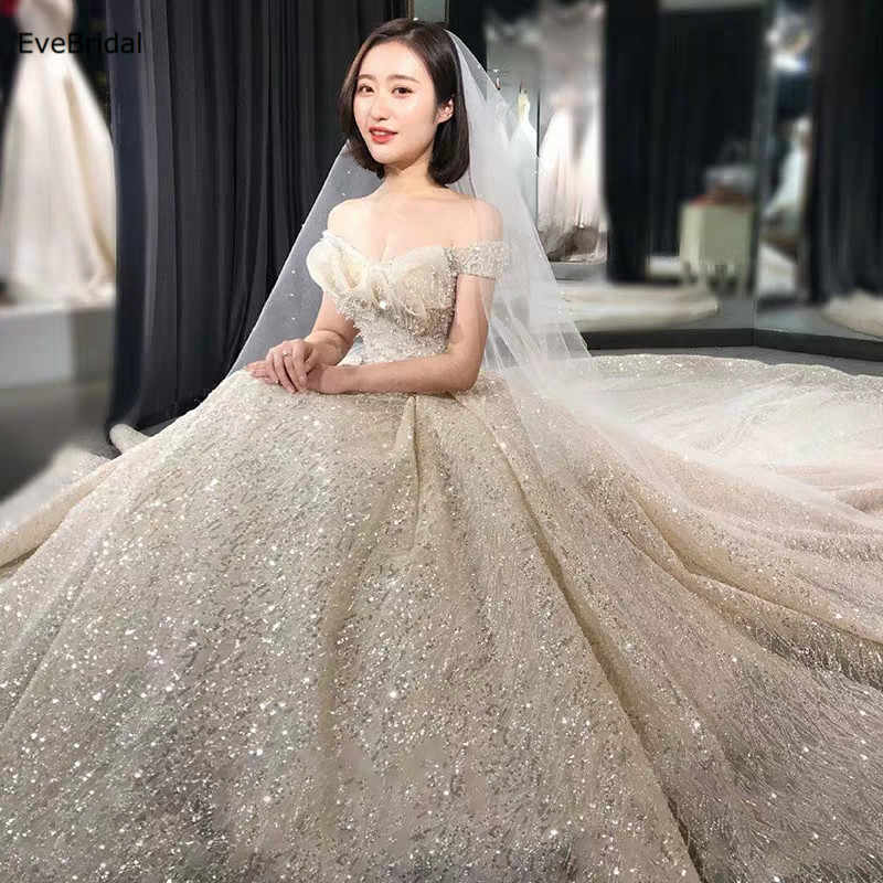 luxurious Wedding Dress Sequined Lace Boat Neck Cap Sleeve Crytals Beading A Line  Floor length Chapel Train Bridal Gown