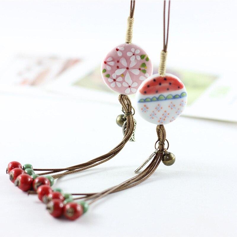 Confident Ceramic Flower Pendant Necklace Hollow Leaves Charm Choker Long Weave Rope Chains For Women Men Sweater Statement Bells Necklace Excellent In Cushion Effect Necklaces & Pendants