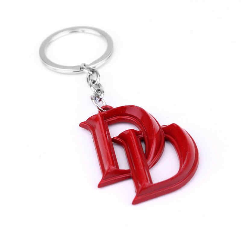 2017ซูเปอร์ฮีโร่ระห่ำพวงกุญแจคู่Dสีแดงเคลือบโลหะพวงกุญแจโซ่H Olderสำหรับรถของที่ระลึกของขวัญแฟนเครื่องประดับ