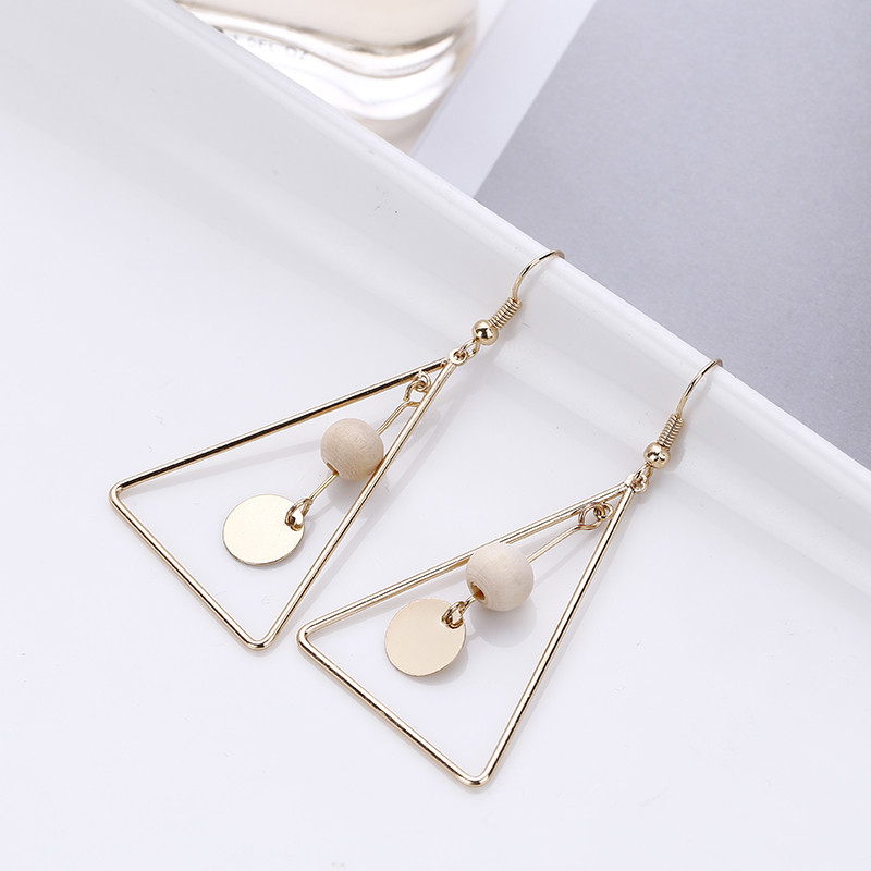 Free shipping Style restoring ancient ways of long triangle hollow out eardrop temperament of natural wood