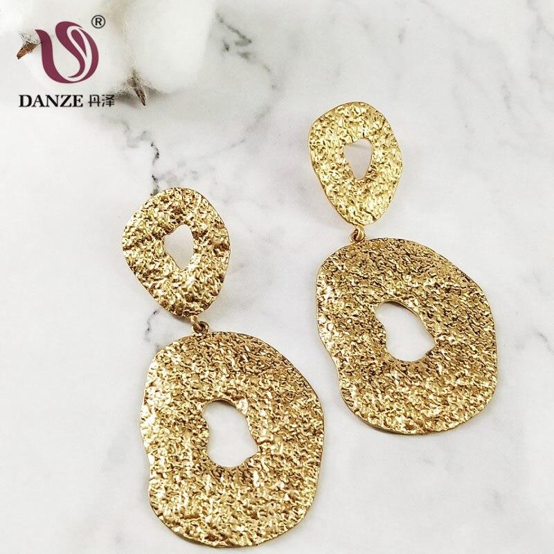 f59502f3f541 Pendientes colgantes ovalados irregulares de exageración DANZE para mujer  Oficina señora encanto geométrico hueco dorado gota de oreja Brincos Aros