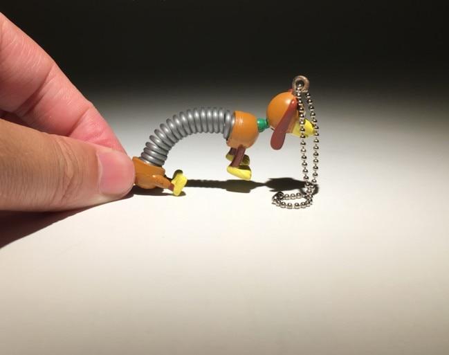6 cm Toy Story Slinky Dog PVC llavero muñeca cachorro perro modelo colgante  de juguete en Acción y Figuras de Juguete de Juguetes y aficiones en ... 1d6109ecb63