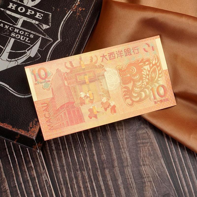 50pcs Macao 10 yuan Atlantic Banknotes Crafts golden plastic Foil paper money