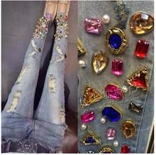 Новый 2014 весна женщины рваные дизайнерские джинсы мода ручной алмазный отверстие украшения тонкие узкие джинсы женщина