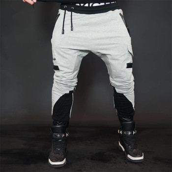 2018 fashon Fitness pantalones largos hombres Casual pantalones de chándal  holgados Jogger pantalones ajustados de moda 217061b6140