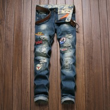 Popular youth badge hole personality quality cotton boutique jeans American style slim straight fashion beggar jeans men 28-38