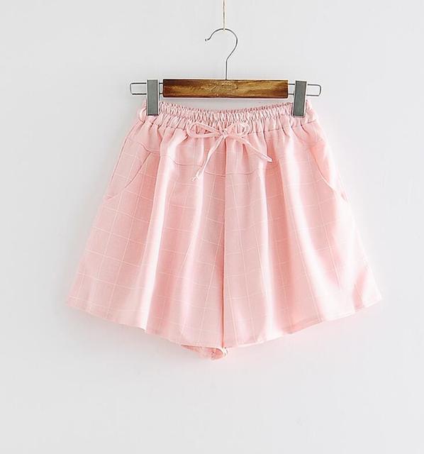 Salvajes pantalones cortos a cuadros ocasionales de las mujeres del verano nuevas pequeñas Culottes frescos