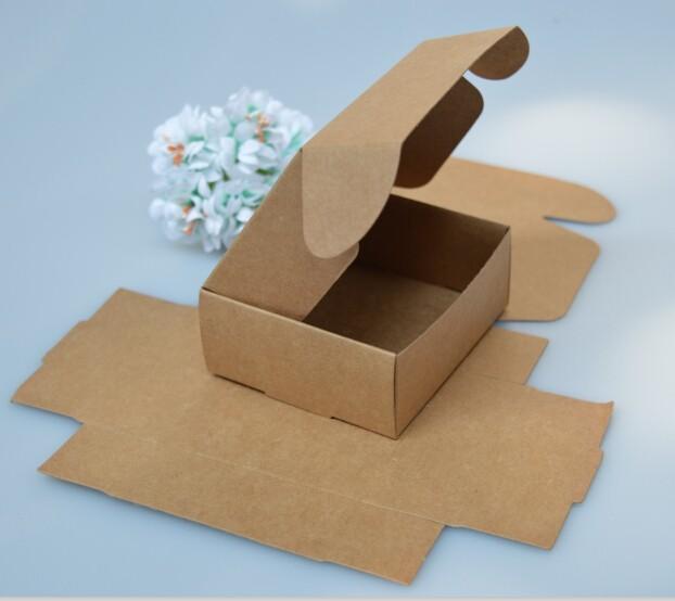 https://ae01.alicdn.com/kf/HTB1yZwmLXXXXXaEXFXXq6xXFXXXe/Joy-small-white-gift-cardboard-boxes-kraft-candy-fold-paper-box-blank-black-paper-pacakging-box.jpg