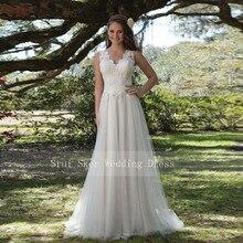 Charming V Neck A Line ชุดแต่งงานลูกไม้สีขาว/งาช้างภาพลวงตากลับ Tulle งานแต่งงานเจ้าสาวชุดยาว