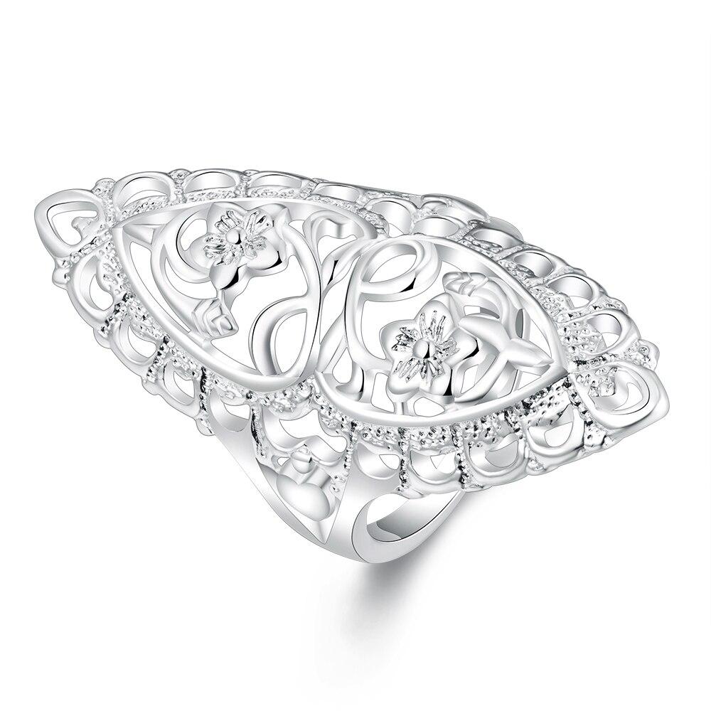 Elegantní kreativní vyřezávané květinové prsteny muži postříbřené módní šperky oválný tvar ženy prsten pro prsty Anillos Hombre Elegante
