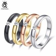 ORSA JEWELS nuevos de moda 316L anillos de acero inoxidable brillante de cristal de las mujeres de los hombres de la boda Anillos De Compromiso 4 colores disponibles OTR48