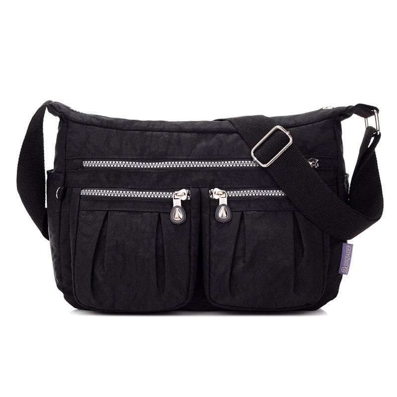 86013b415953 Hot New Spring Fashion Waterproof Nylon HandBags Solid Zipper Travel  Crossbody Bag High Quality Women Trunk