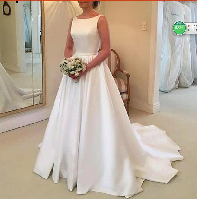 Elegant Long Beach A Line Satin Wedding Dress 2018 Sleeveless White Bridal  Gown Online Chinese Store robe de bal rouge 48d3fddffb97