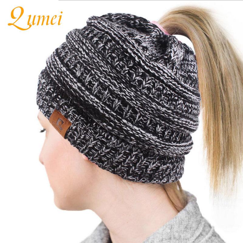 1PCS Drop Shipping 2018 Soft Knit Ponytail Beanie Warm Winter Hats For Women Beanie Hat Stretch Cable Messy Bun Hats Ski Cap B4