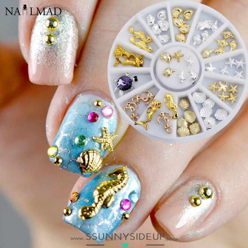1 caja de metal Sea Horse Shell Nail Studs oro plata estrella de mar 3D Nail Art Decoration para UV acrílico uñas accesorios en la rueda
