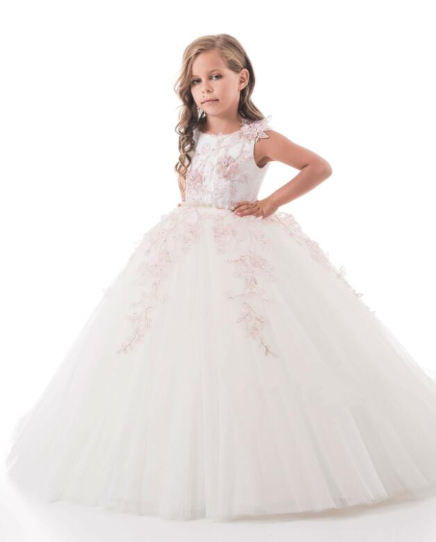 купить luxury ball gown sheer back lace appliques flower girl dresses first communion gown with long train pearls по цене 7815.41 рублей