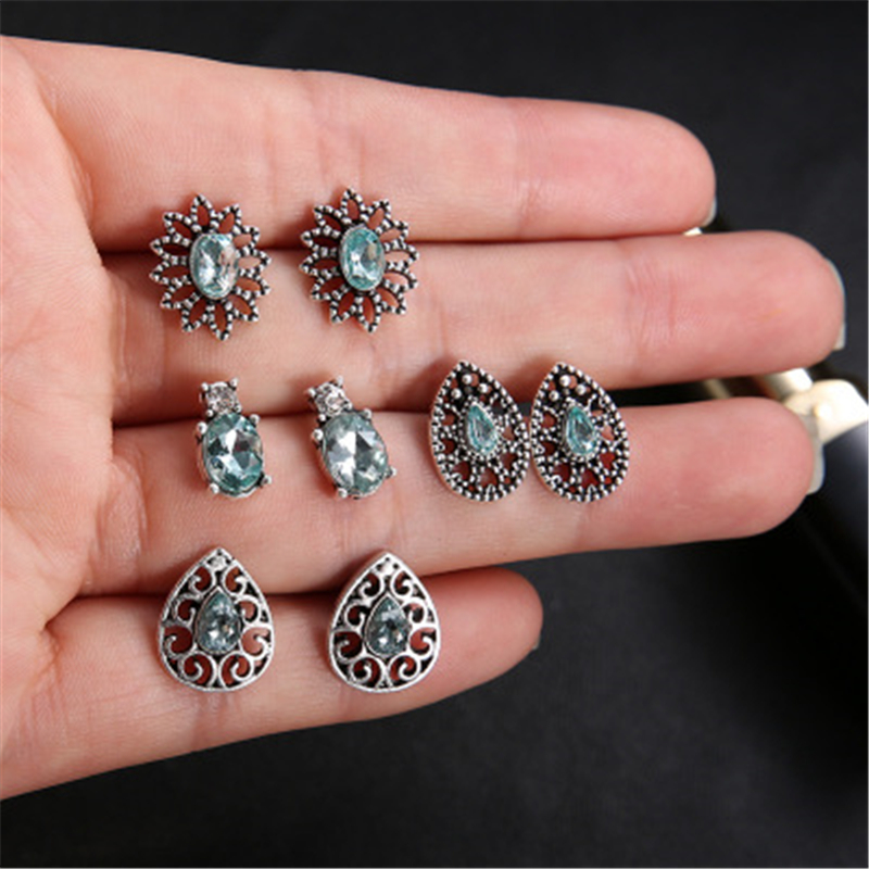 Fashion earrings sun flower decoration pair of silver retro blue crystal hollow earrings ladies party gifts 2019 new hot sale in Stud Earrings from Jewelry Accessories