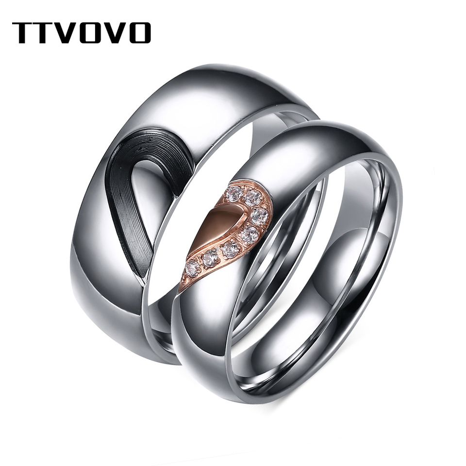 It is a photo of TTVOVO Matching Promise Rings for Couples Wedding Bands for Him & Her Puzzle Heart Ring Stainless Steel CZ Stone Engagement Ring