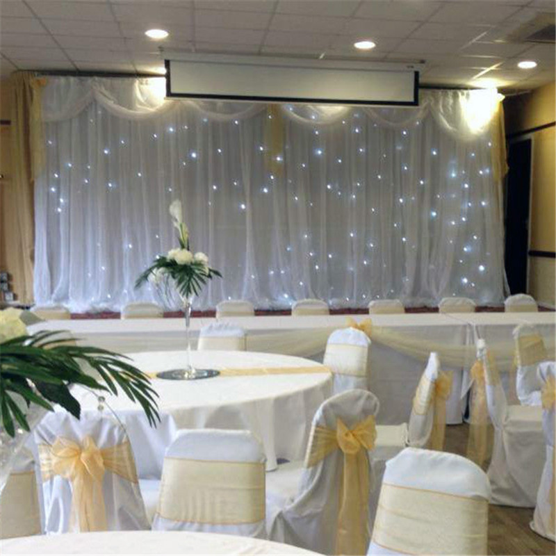 Good quality led star curtain white backdrop for wedding decoration with front organza and top swags 10ftx20ft wedding backdropGood quality led star curtain white backdrop for wedding decoration with front organza and top swags 10ftx20ft wedding backdrop