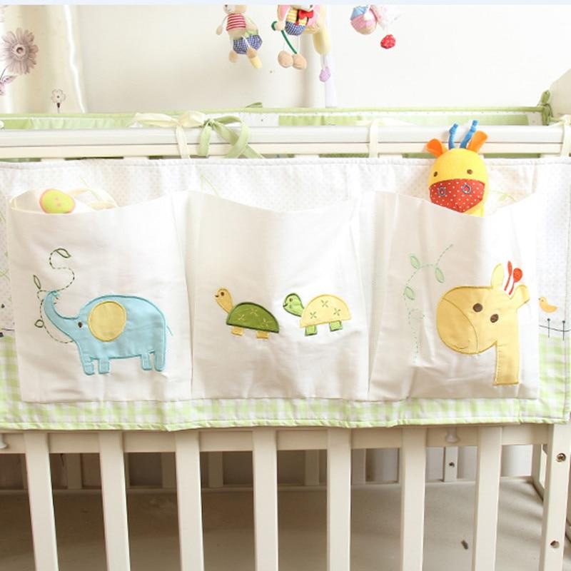 Körpə bamperi Pambıq çarpayısı tənzimləyicisi Baby Cot yataq asma saxlama çantası oyuncaq uşaq bezi cib cib
