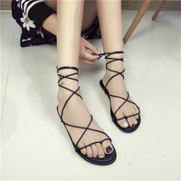Europe and the United States new toe shoes flat shoes cross straps flat with Roman sandals female size code sandals beach shoes