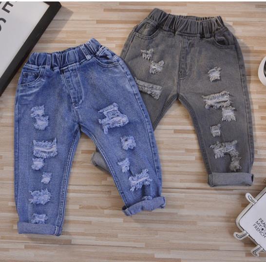 2017 Весна горячая новая мода мальчиков и девочек хлопка свободные отверстия детские джинсы выбрать размер