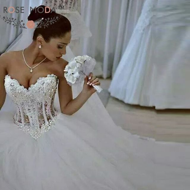 Gorgeous Sheer Ball Gown Wedding Dresses 2017 Puffy Beaded: Brilliant Heavily Pearl Beaded See Through Lace Corset