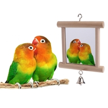 лучшая цена Natural Wood Pet Parrot Birds Toy With Bell Double Side Mirror Hang On Cage Swing Play Budgie Grinding Station Rack